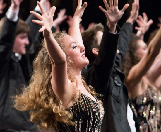 A student performing in show choir