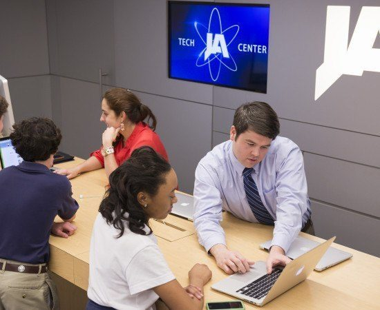 A student gets assistance at the technology center
