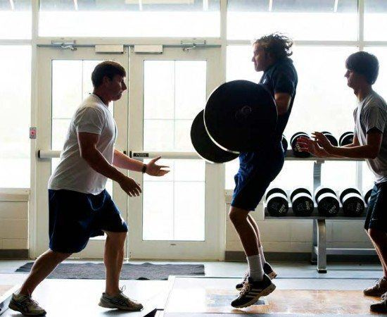 Students work out in the weight room